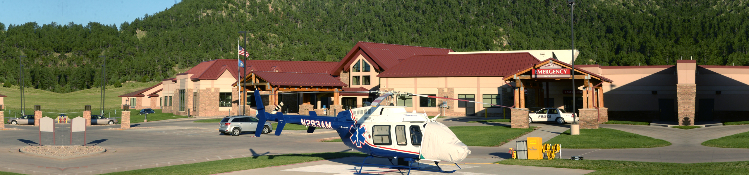 Banner is a picture of the hospital with a police car in the entrance and a Medical Helicopter on the landing pad.