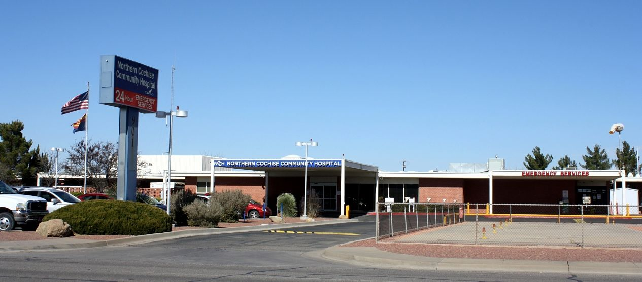 The entrance of Northern Cochise Community Hospital with the Unites States flag blowing in the front