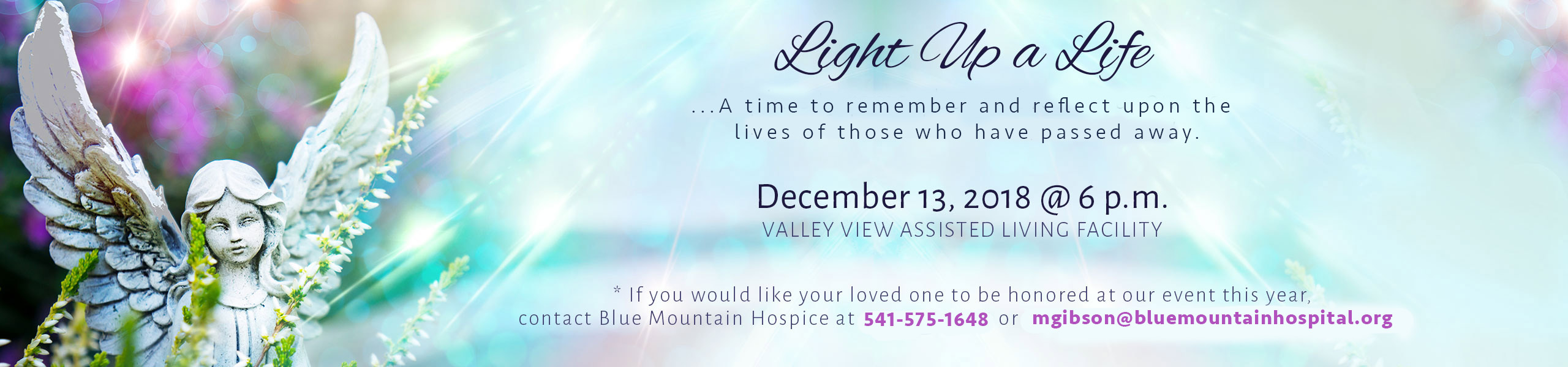 """""""Light Up A Life"""" - angel statue behind greenery with purple & blue reflections and rays of light from above in a soft aqua blue background"""