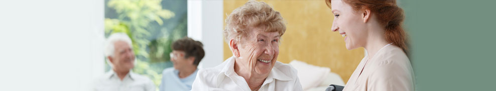 This is a banner of a elderly lady laughing while talking with a younger female