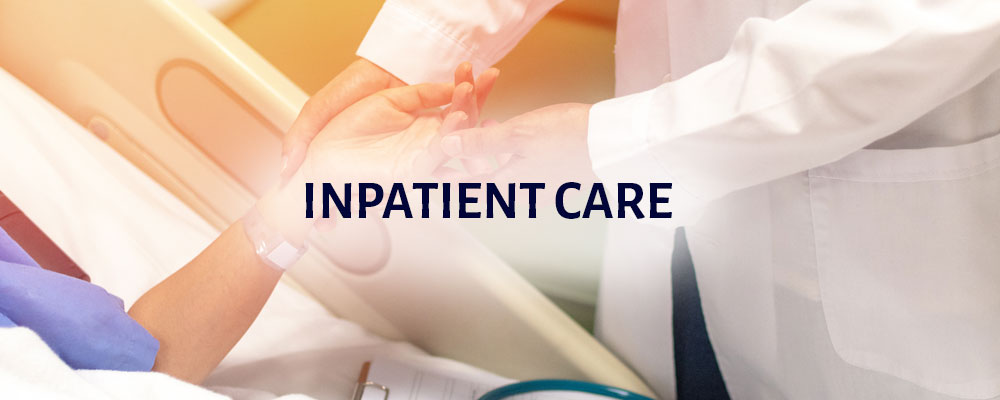 Inpatient Care: a health professional is holding a patient's hand and checking their pulse