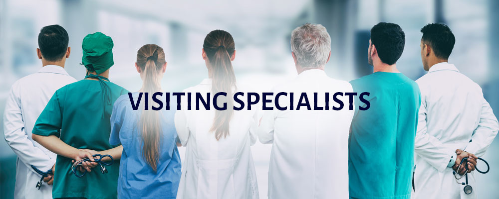 Visiting Specialists with an image of seven health professionals dressed in a variety of medical attire, scrubs, surgical gowns, and lab coats