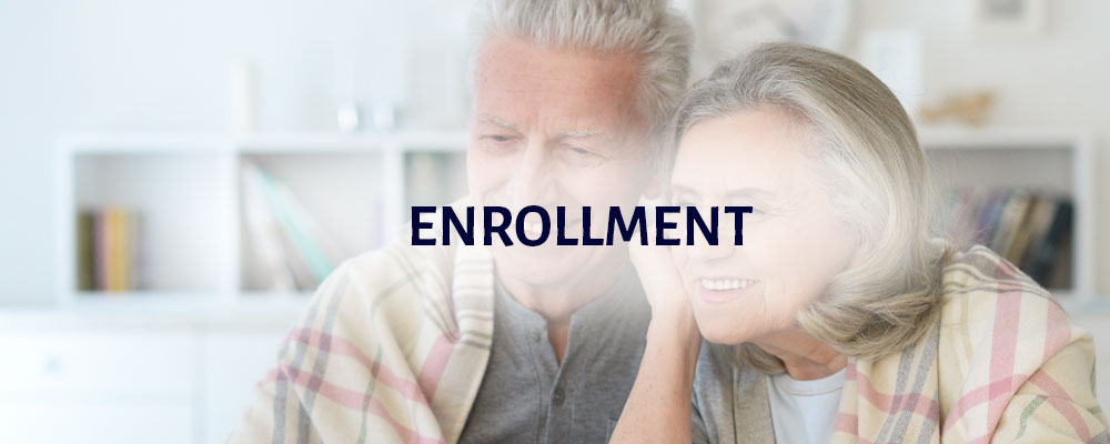 Enrollment: an elderly couple is smiling and hugging one another