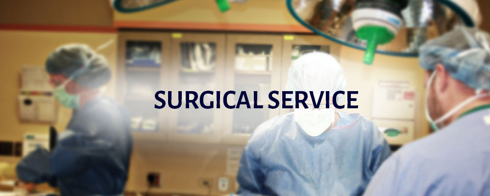 Surgical Service: three surgeons are fully dressed in operating attire