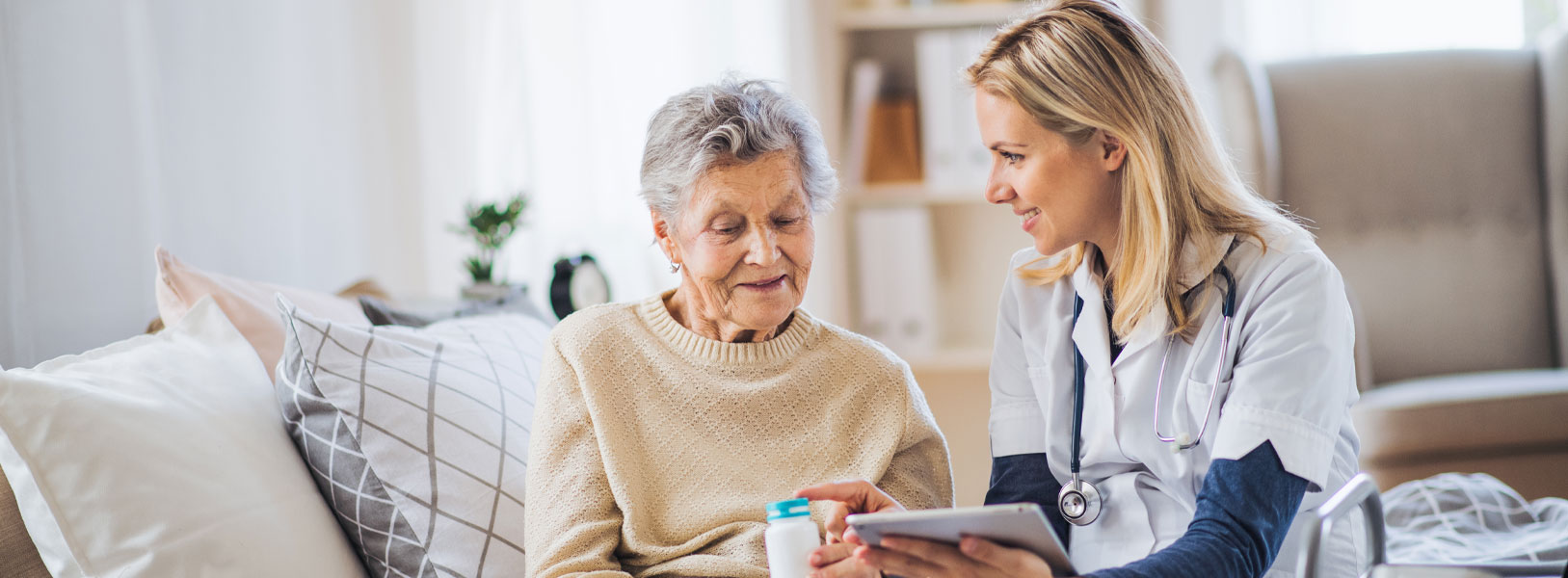 A female nurse is explaining to an elderly woman on what to do