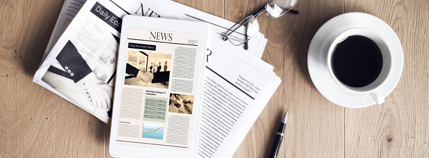 A pile of papers that are news related placed on a table
