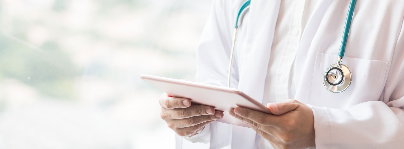 A doctor is holding a clip board