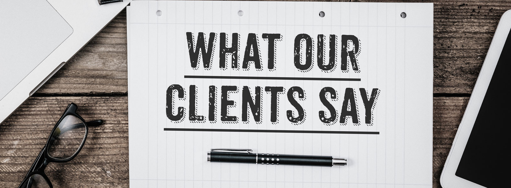 "An image of a piece of paper with writing that says, ""What our clients say"""
