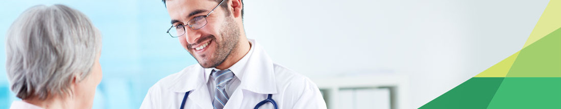 Find A Provider: a doctor is smiling at a patient