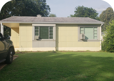 Picture is of the small Lustron Home in The Summer Sunlight.