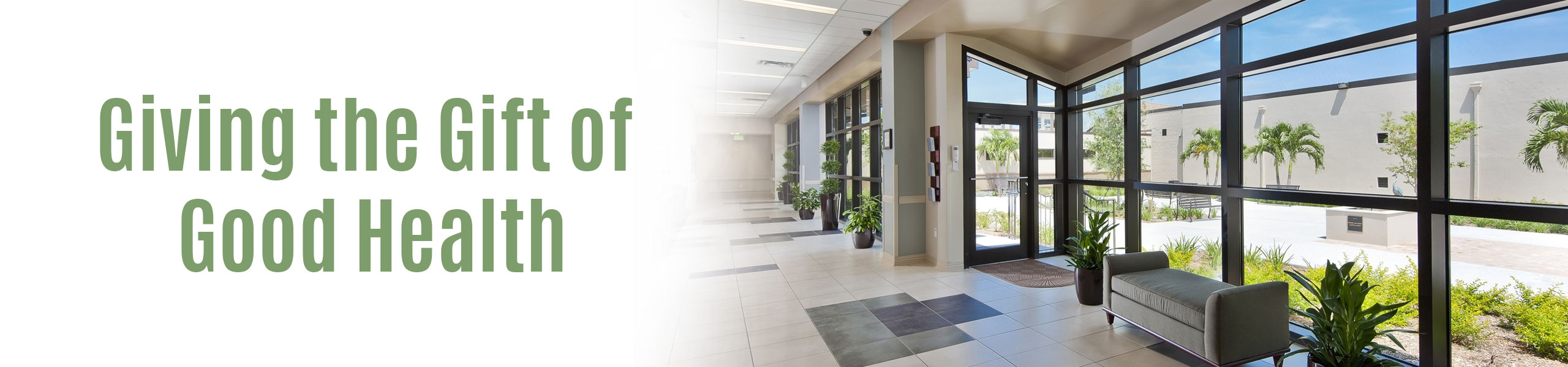 """Picture of The Hendry Regional Center Hospital Lobby Area Banner says: """"Giving The Gift of Good Health"""""""