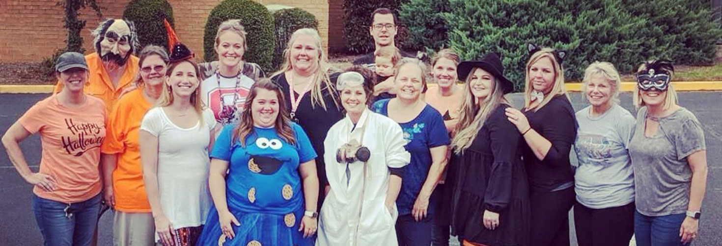 Pictured is a group of employees dressed up in costumes.