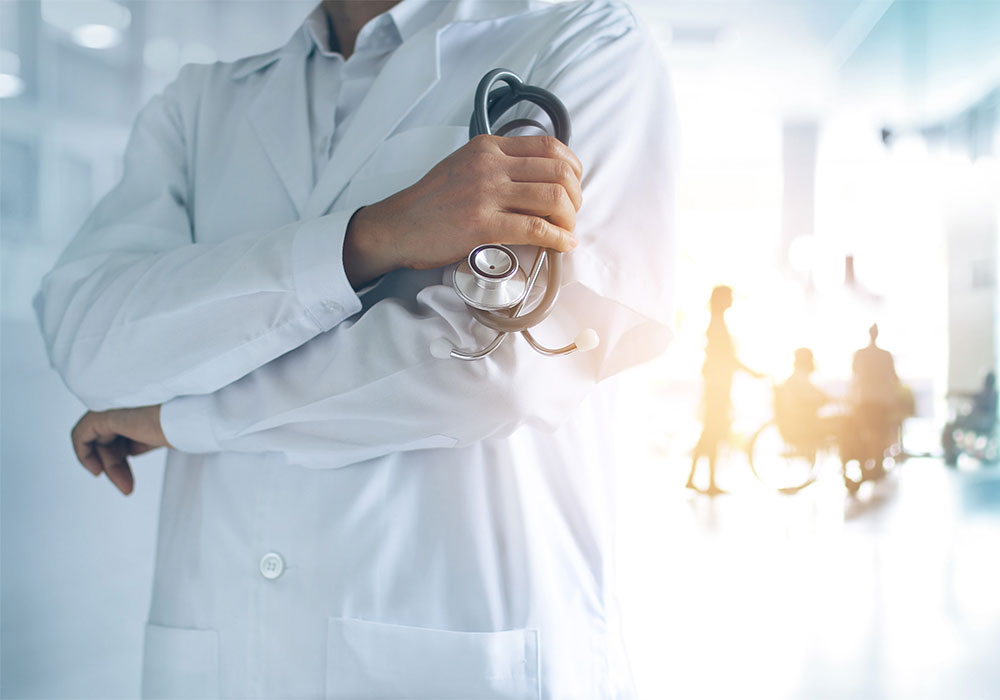 Picture of a physician holding a stethoscope.