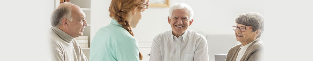 This is a picture of a nurse talking to some elderly people