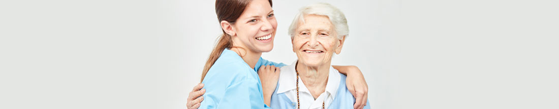 This a picture of a nurse and elderly person smiling