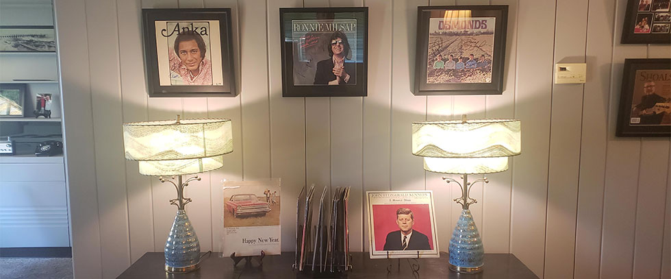A display wall full of pictures and records from various artist