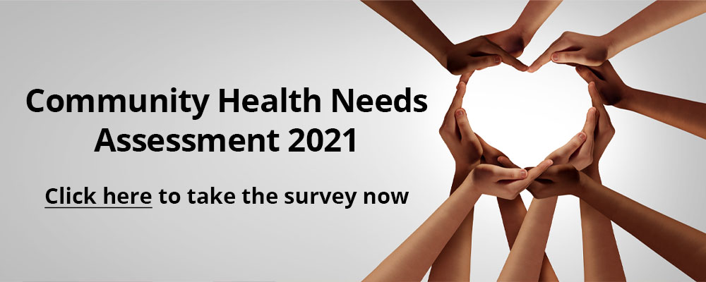 Heart shape made out of hands  The Banner reads Community Health Needs Assessment 2021. Click here to take the survey now